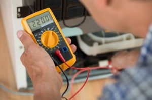 man using a multimeter